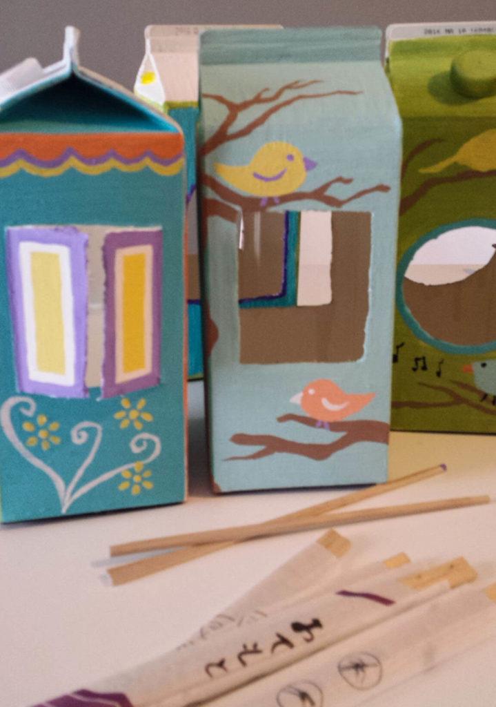 milk carton,juice carton,bird feeder,chopsticks