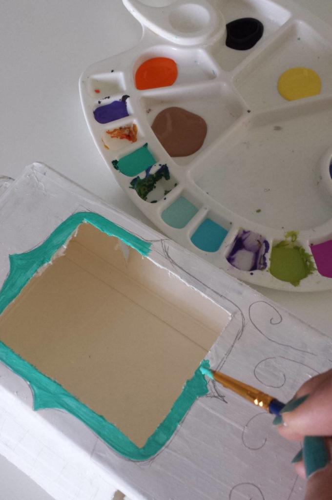 milk carton,juice carton,bird feeder,painting