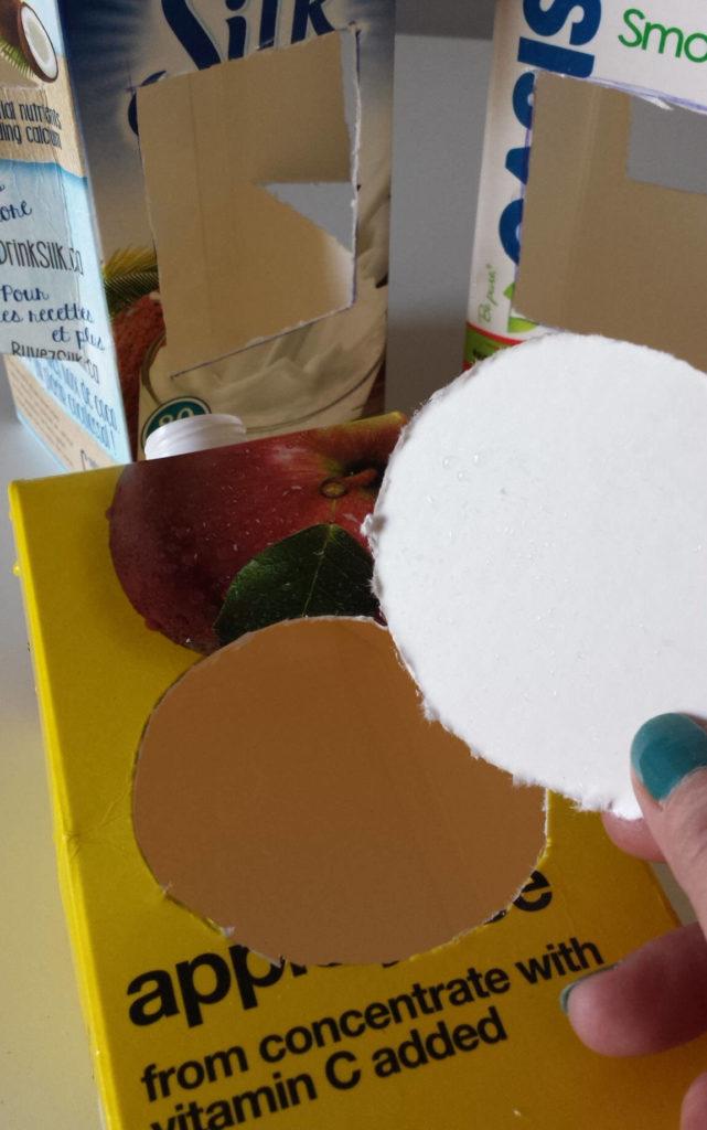 milk carton,juice carton,bird feeder,round,hole