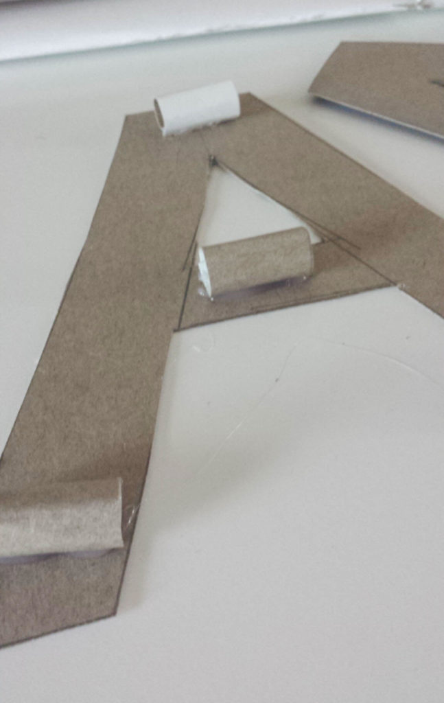 cardboard cylinder on monogram diy