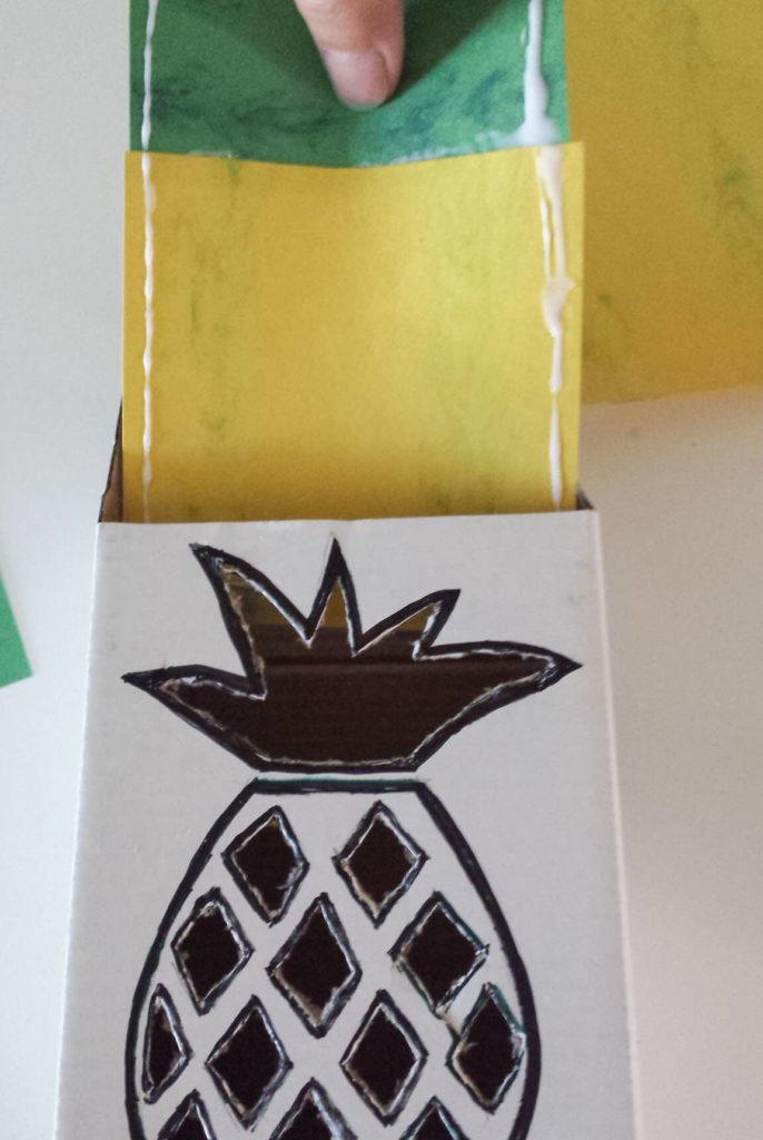 slide paper inside box