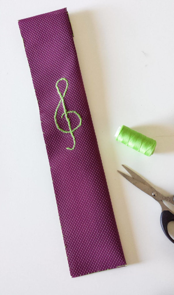 embroidered treble clef on placemat