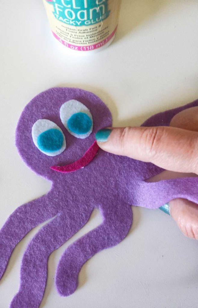 glue parts to octopus coffee sleeve diy