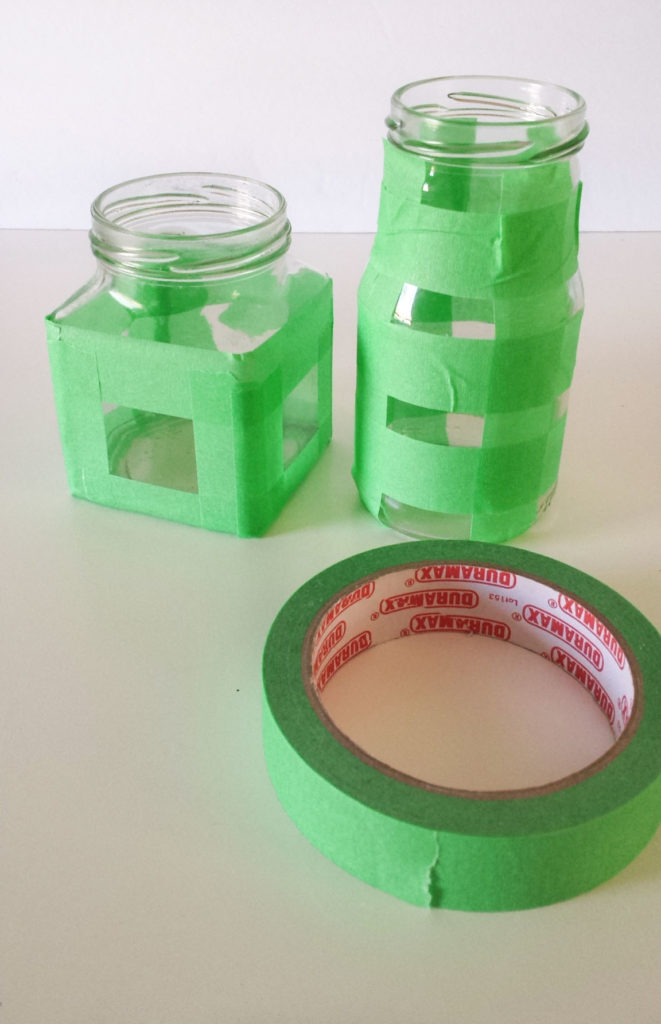 painters tape on containers for desk organizer