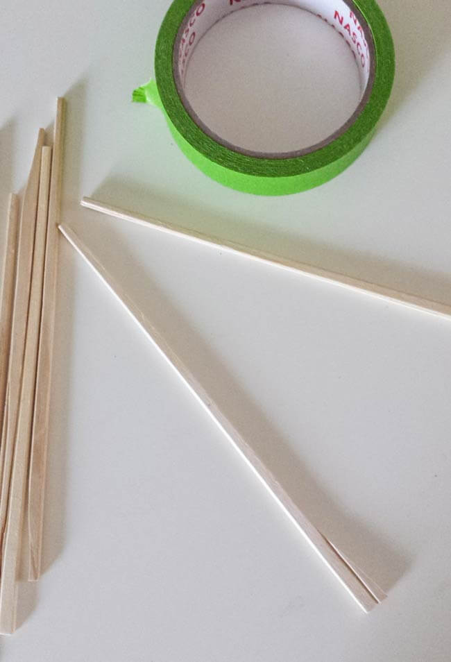 chopsticks and painter's tape for paper ornament diy