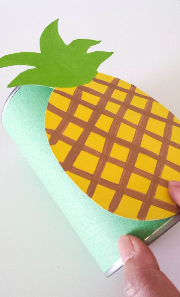 attach pineapple on tin can diy