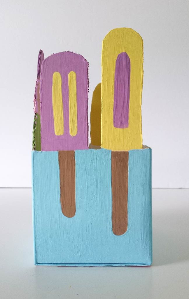 painted popsicles on a reused box