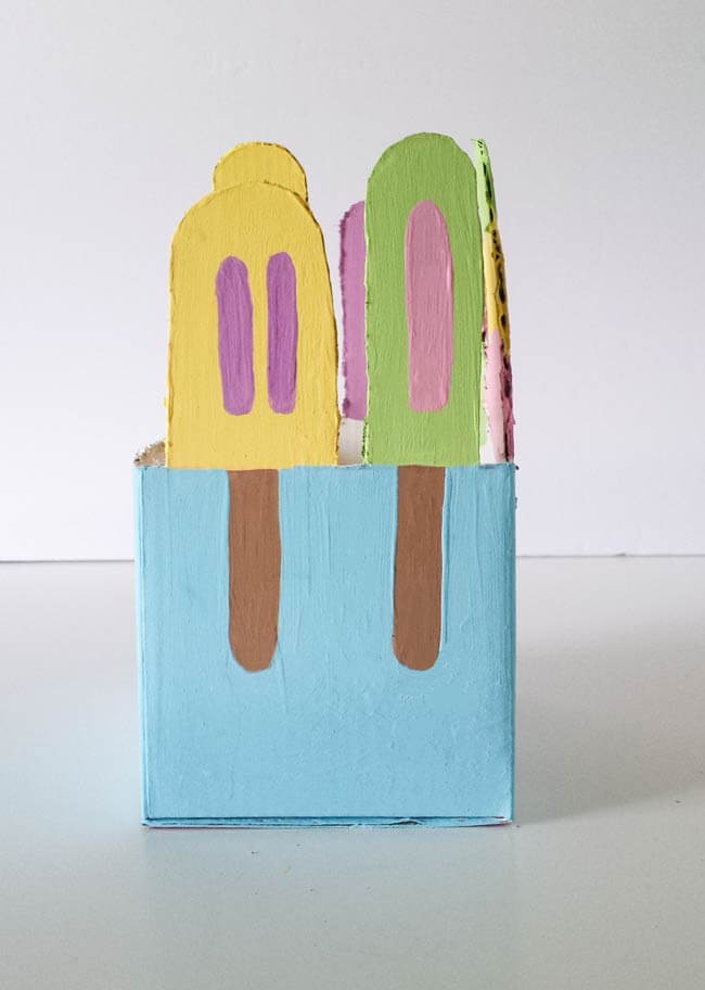 painted popsicles on repurposed box