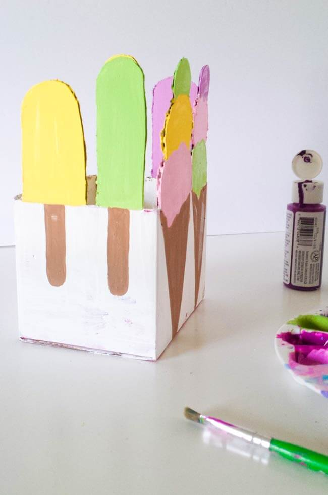 painted popsicles on repurpose box