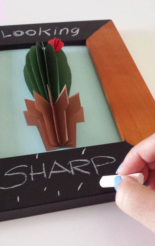 write on chalkboard frame of cactus wall art